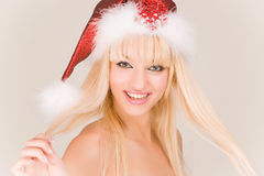 Laughing mrs. Santa. In red hat stock photos