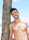 Laughing muscular latin guy at beach Royalty Free Stock Images