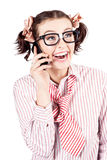 Laughing nerdy woman on a smartphone Royalty Free Stock Image