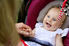 Laughing Newborn Baby Girl in Car Seat Stock Photos