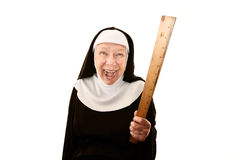 Laughing nun brandishing a ruler Royalty Free Stock Photography