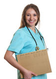 Laughing nurse with medical file Stock Photos