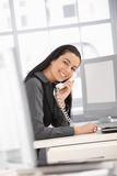 Laughing office worker Stock Photography