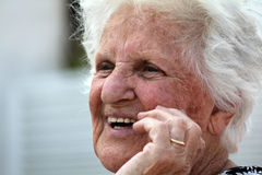 Laughing old lady. A beautiful old lady laughing Royalty Free Stock Images