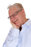 Laughing older man. A happy older man with one hand on his face and glasses, laughing, isolated for white background stock images