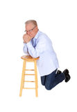 Laughing older man. A happy older man with one hand on his face and glasses, laughing, isolated for white background royalty free stock photography