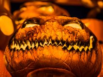 Laughing of the orange scary pumpkin with the glowing light insi stock photos