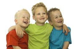 Laughing Out Loud. Three friends laughing, holding each other and having fun royalty free stock photo