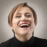 Laughing Out Loud. Woman with short red hair laughing out loud Stock Photos
