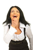 Laughing out loud business woman. Holding her chin  isolated on white background Stock Photography