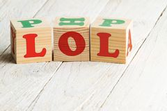 Laughing out loud. LOL sign. Wooden blocks on a white wooden background Royalty Free Stock Photography