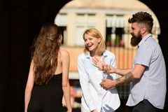 Laughing out loud. People enjoying each others company. Bearded man and pretty women smiling on street. Boyfriend dating. Laughing out loud. People enjoying each stock image