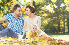Laughing parents with cute child Royalty Free Stock Photos