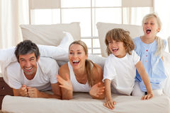Laughing parents playing with their children Royalty Free Stock Photography
