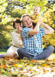 Laughing parents and their cute baby Royalty Free Stock Image