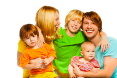 Laughing parents with three kids Stock Photography