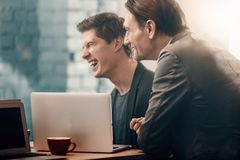 Laughing partners having job together royalty free stock photos