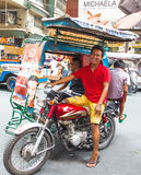 Laughing passenger tricycle driver in Manila, Philippines. A tricycle driver enjoys a laugh in Divisoria Market, Manila's largest street market in the Royalty Free Stock Images