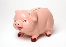 Laughing Piggy Bank on White. Piggy bank with a laughing expression on a white background Royalty Free Stock Photos