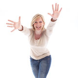 Laughing playful woman with outstretched arms. And hands extended leaning towards the camera isolated on white Royalty Free Stock Image