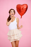 Laughing playful woman with a red heart Royalty Free Stock Photo