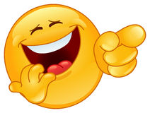 Laughing and pointing emoticon Stock Photo