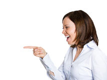 Laughing pointing woman Stock Images