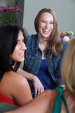 Laughing Pregnant Woman. Beautiful young pregnant women laughs with friends Royalty Free Stock Photos