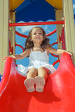 Laughing preschool girl at the playground Royalty Free Stock Images