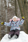 Laughing preschooler girl wearing warm clothing Royalty Free Stock Photography