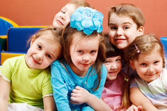 Laughing preschoolers. Crowd of preschool kids laughing Stock Image