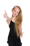 Laughing  preteen girl holds her thumbs up Royalty Free Stock Images