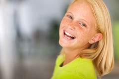 Laughing preteen girl. Looking back headshot Stock Photography