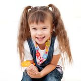 Laughing pretty girl with lollipop Royalty Free Stock Images