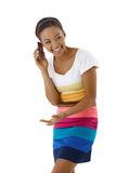 Laughing pretty girl on phone call stock image