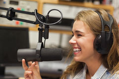 Laughing pretty radio host moderating Stock Photo