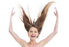 Laughing pretty woman throwing her hair up Royalty Free Stock Photography