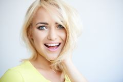 Laughing pretty young blond woman Stock Images