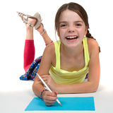 Laughing Primary Aged Girl Drawing Stock Photography