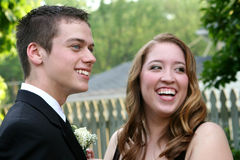 Laughing Prom Couple Showing Boutonniere Royalty Free Stock Photography