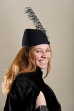 Laughing redhead in feathered hat and coat Stock Photos