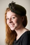 Laughing redhead in green hat with bow Royalty Free Stock Photos