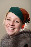 Laughing redhead in green hat and fur Royalty Free Stock Image
