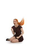 Laughing redhead woman flicking her hair Royalty Free Stock Photos