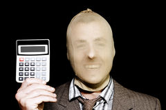 Laughing Robber Holding Calculator On Black Stock Photography
