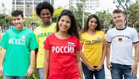 Laughing russian sports fan with supporters from Mexico, Brazil,. Colombia and Germany outdoors on way to stadium Royalty Free Stock Photo