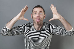 Laughing 40s man acting like a clown with fun body language Royalty Free Stock Photos