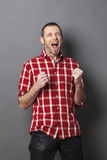 Laughing 40s man shouting for victory Stock Photos