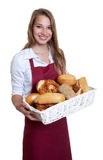 Laughing saleswoman of the bakery Royalty Free Stock Photo