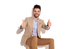 Laughing seated business man making the ok sign Stock Photo